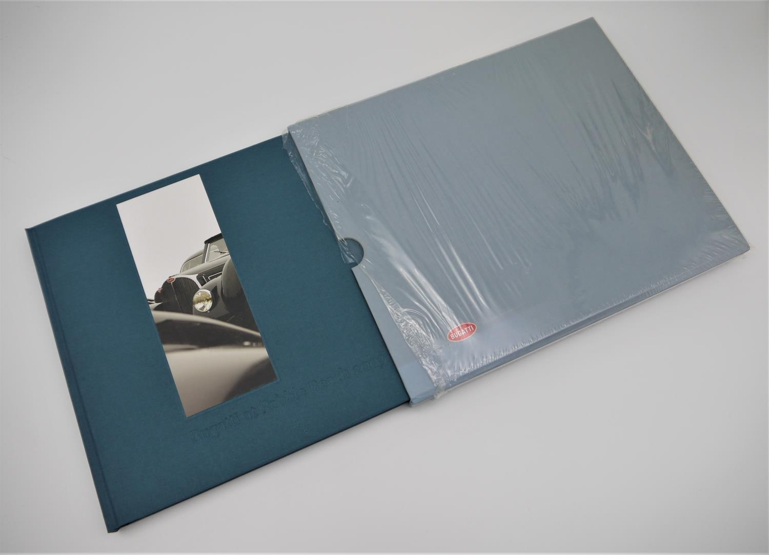 BUGATTI AUTOMOBILES: BUGATTI AT PEBBLE BEACH 2003 with numerous photographs, this book details the