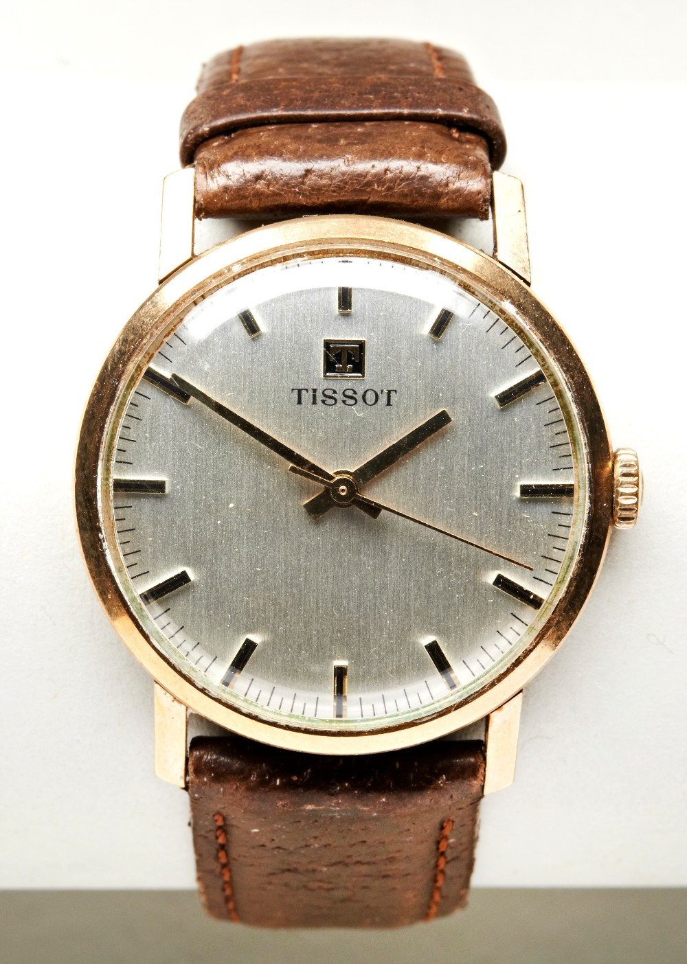 TISSOT 9CT MAN'S WRISTWATCH, 1970s, the plain slivered dial with baton numerals and later leather