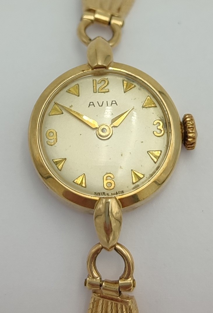 LADIES AVIA 9CT GOLD BRACELT WRIST WATCH the champagne dial with Arabic numerals and pyramid hour