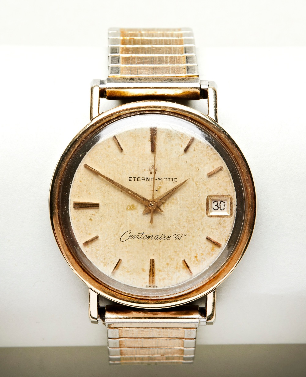 ETERNA MATIC GOLD-PLATED CENTENAIRE 61' BRACELET WRISTWATCH the champagne dial with baton numerals