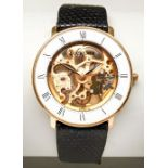 BUCHERER GOLD PLATED MANUAL WIND SKELETON WATCH, the white chapter ring with Roman numerals