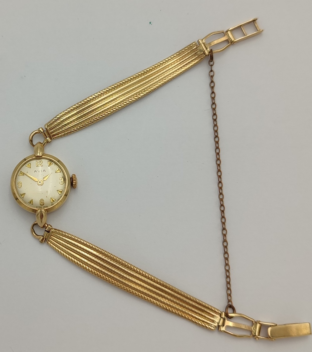 LADIES AVIA 9CT GOLD BRACELT WRIST WATCH the champagne dial with Arabic numerals and pyramid hour - Image 4 of 4