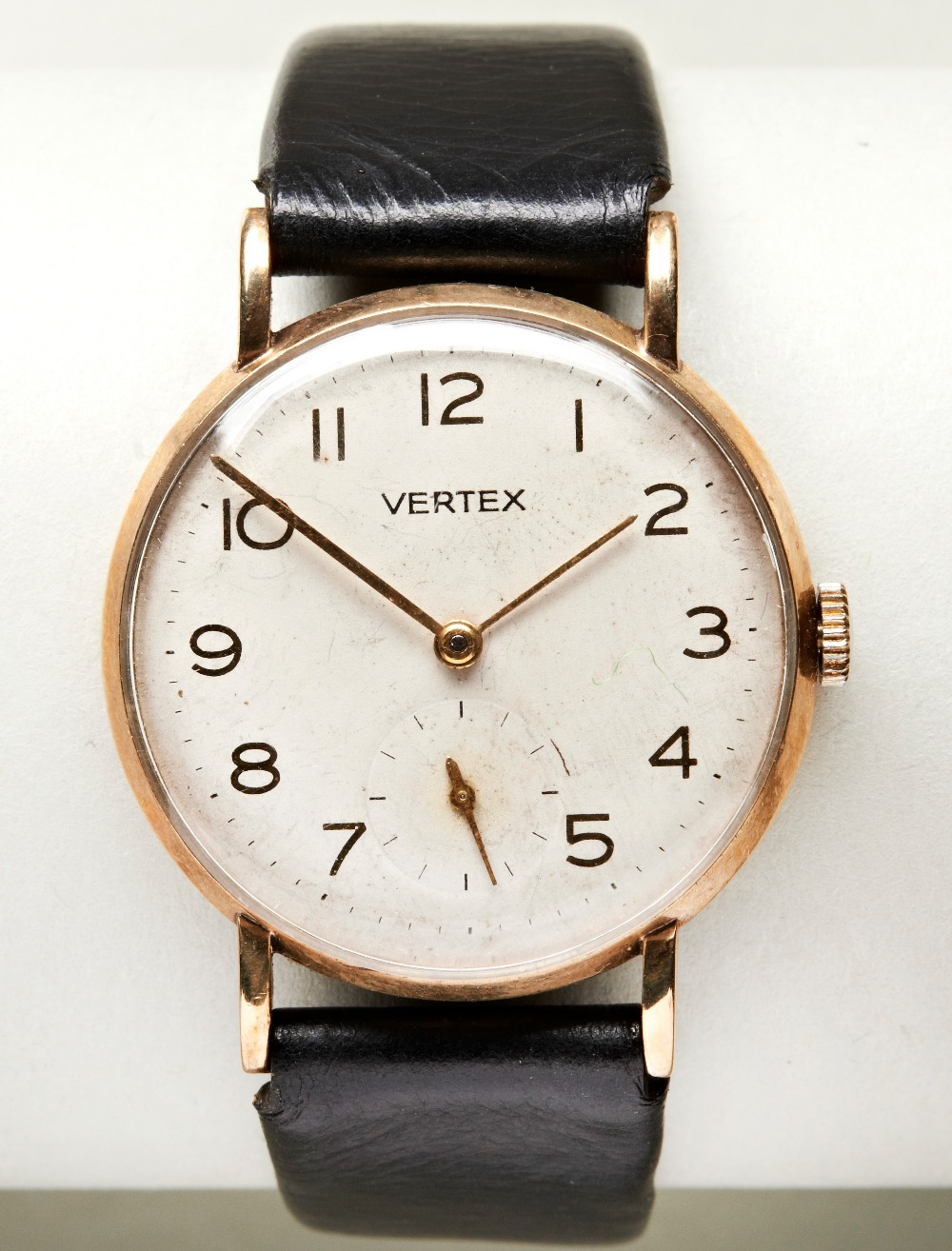 VERTEX 9CT MAN'S DRESS WATCH, c1960, with Arabic numerals and later leather strap. PROVENANCE: The