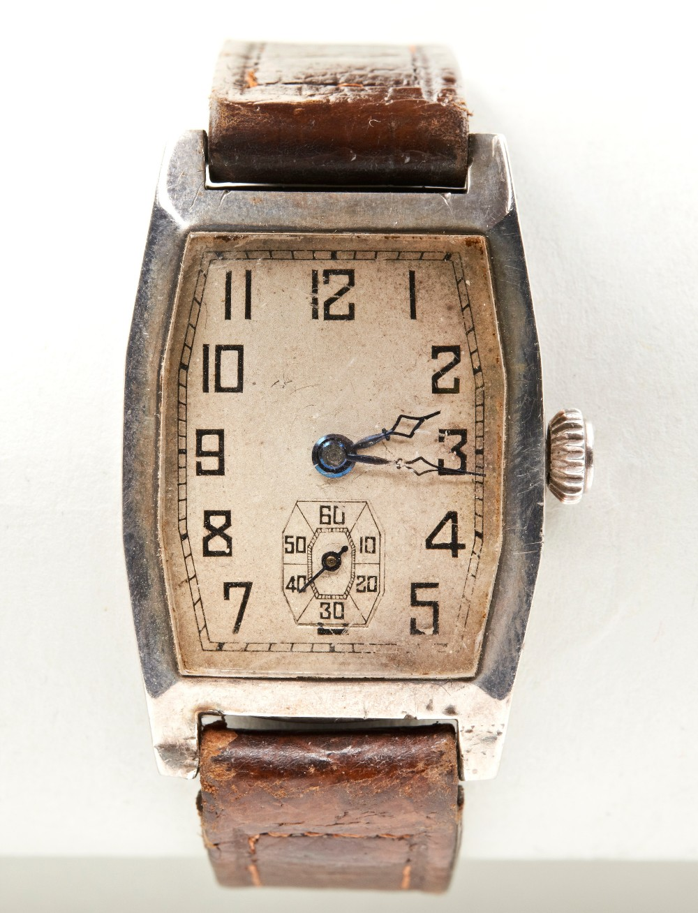 SWISS SILVER TONNEAU SHAPED MANUAL WRISTWATCH, c1915, the ?silver? dial with Arabic numerals, the