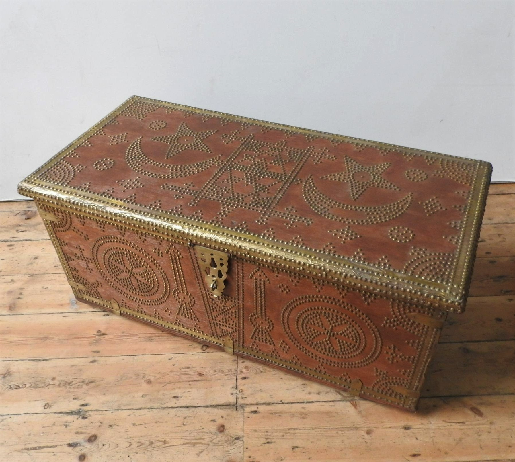 A MIDDLE EASTERN BRASS STUDDED BLANKET CHEST, with moon and star decoration, with two handles 47 x - Image 2 of 3