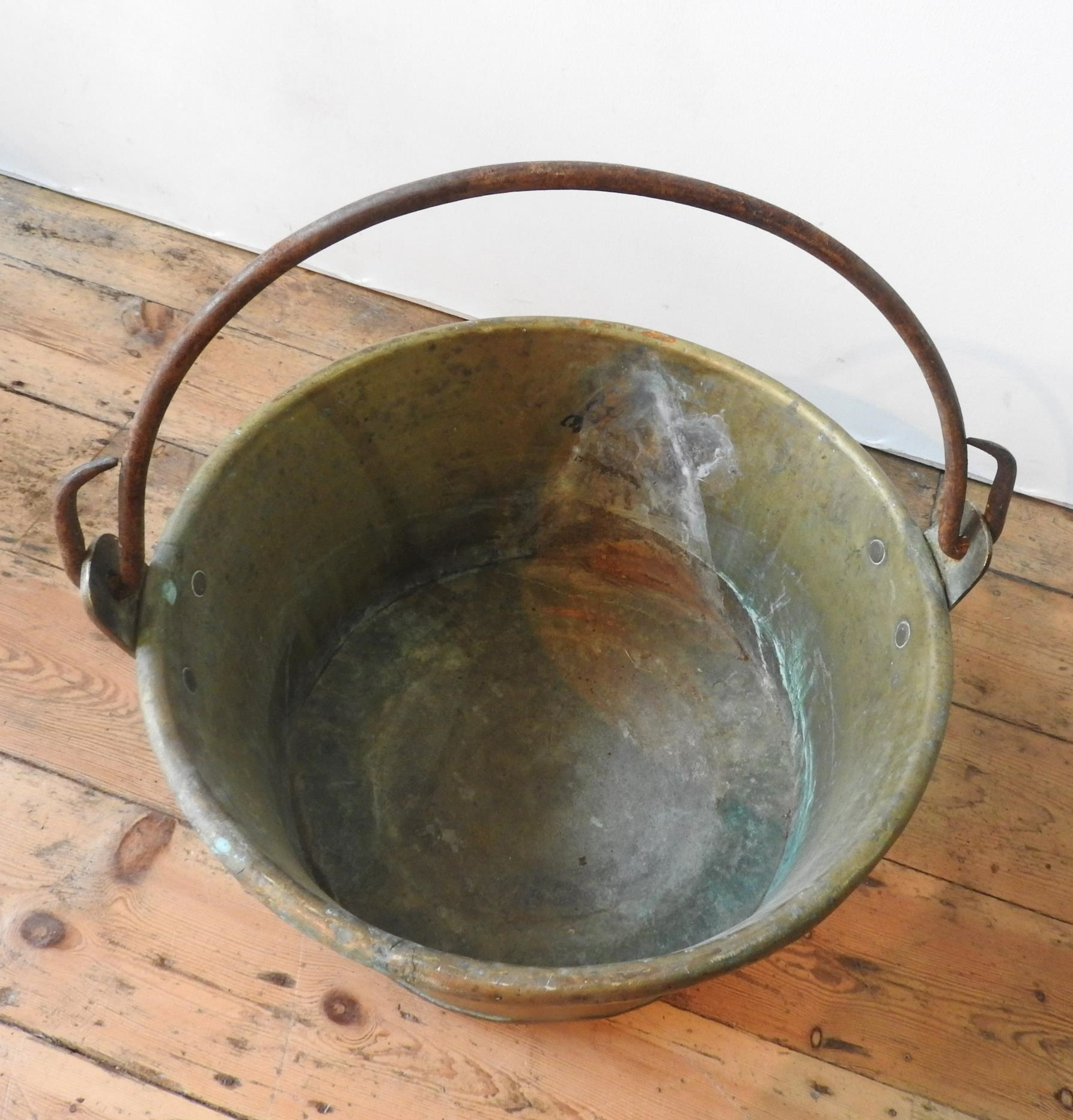 A CONTINENTAL RIVETED BRASS BUCKET WITH IRON RING HANDLE, 52cm dia - Image 2 of 2