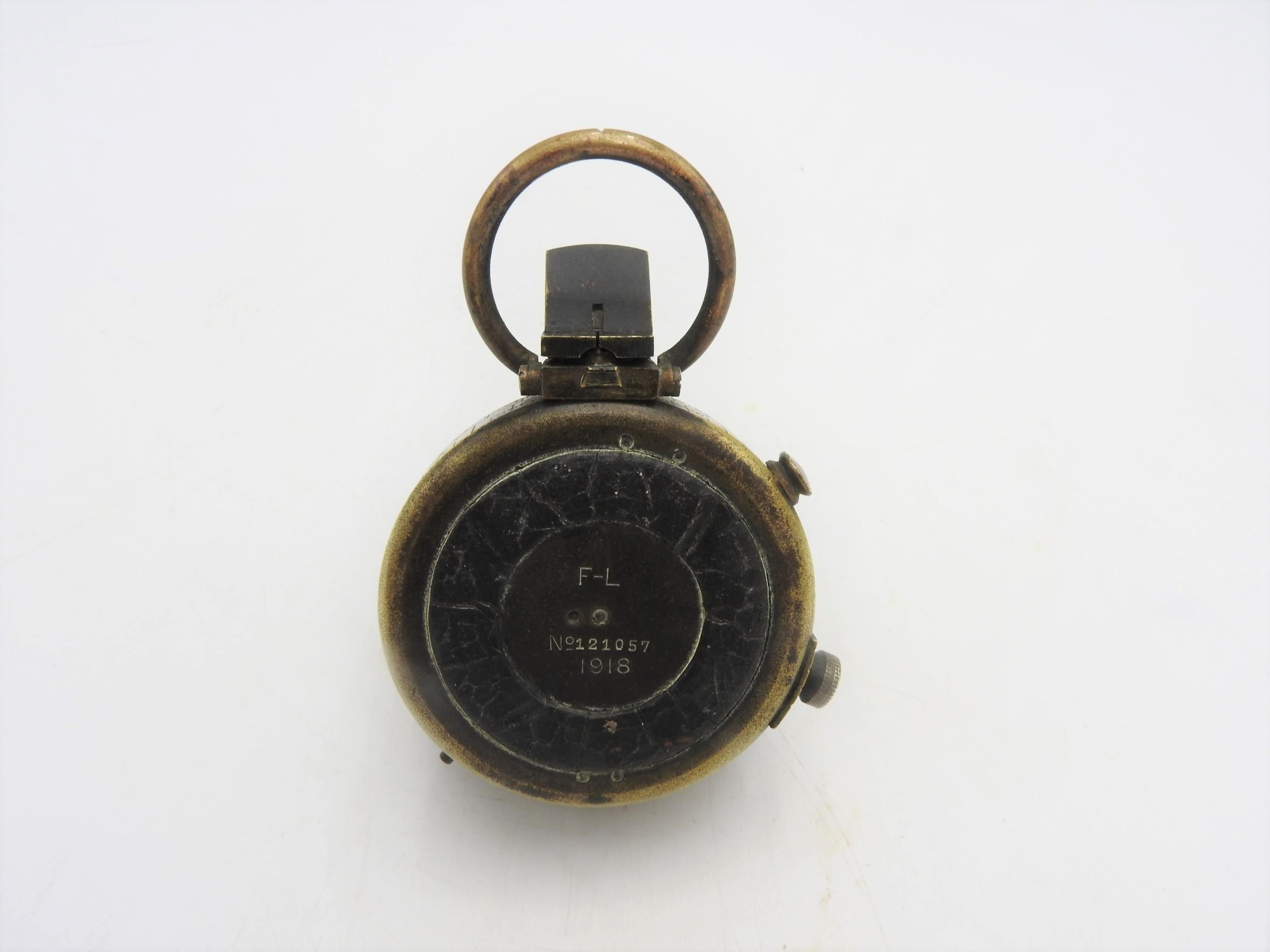 A BRASS FIRST WORLD WAR COMPASS, inscribed on the reverse F-L, No.121057, 1918, 5 cm dia - Image 2 of 3