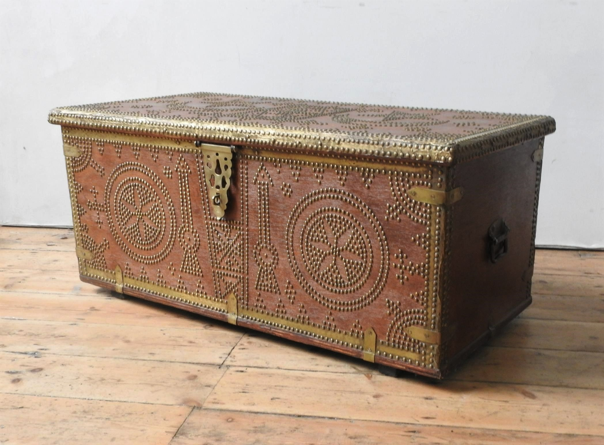 A MIDDLE EASTERN BRASS STUDDED BLANKET CHEST, with moon and star decoration, with two handles 47 x