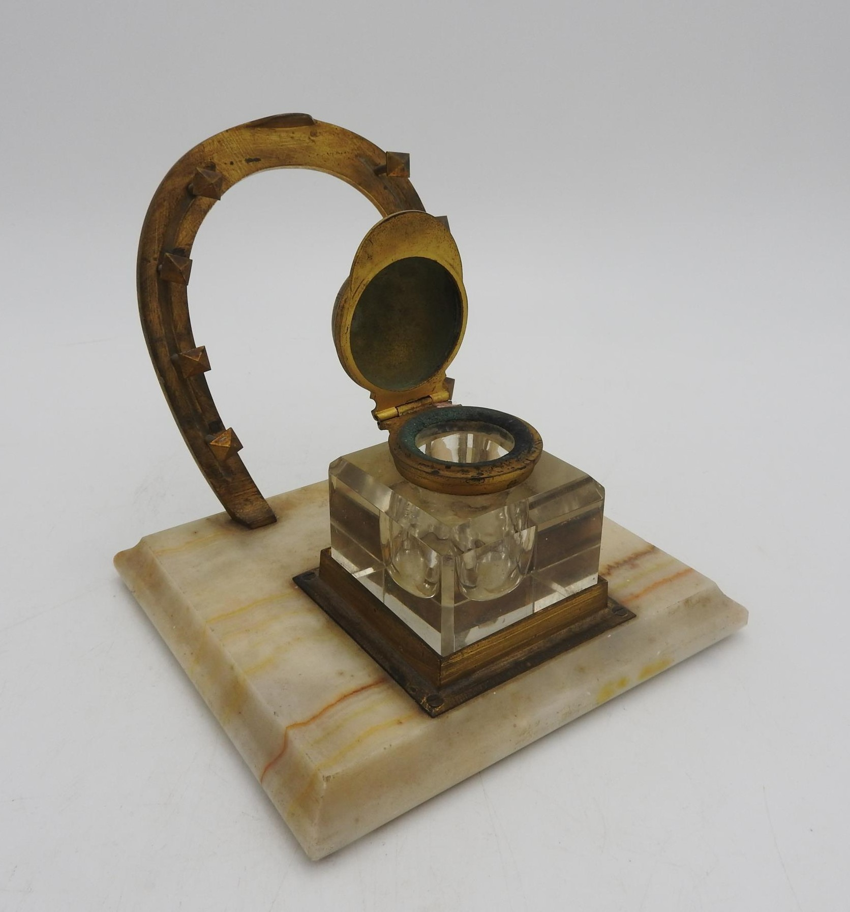 A NOVELTY JOCKEY'S INKWELL STAND, comprising of a horseshoe shaped pen rack and an inkwell with a - Image 3 of 4