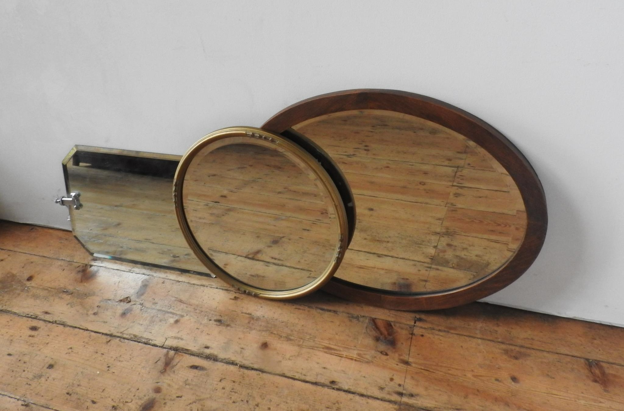 MAHOGANY FRAMED OVAL MIRROR, GILT CIRCULAR MIRROR AND ONE OTHER