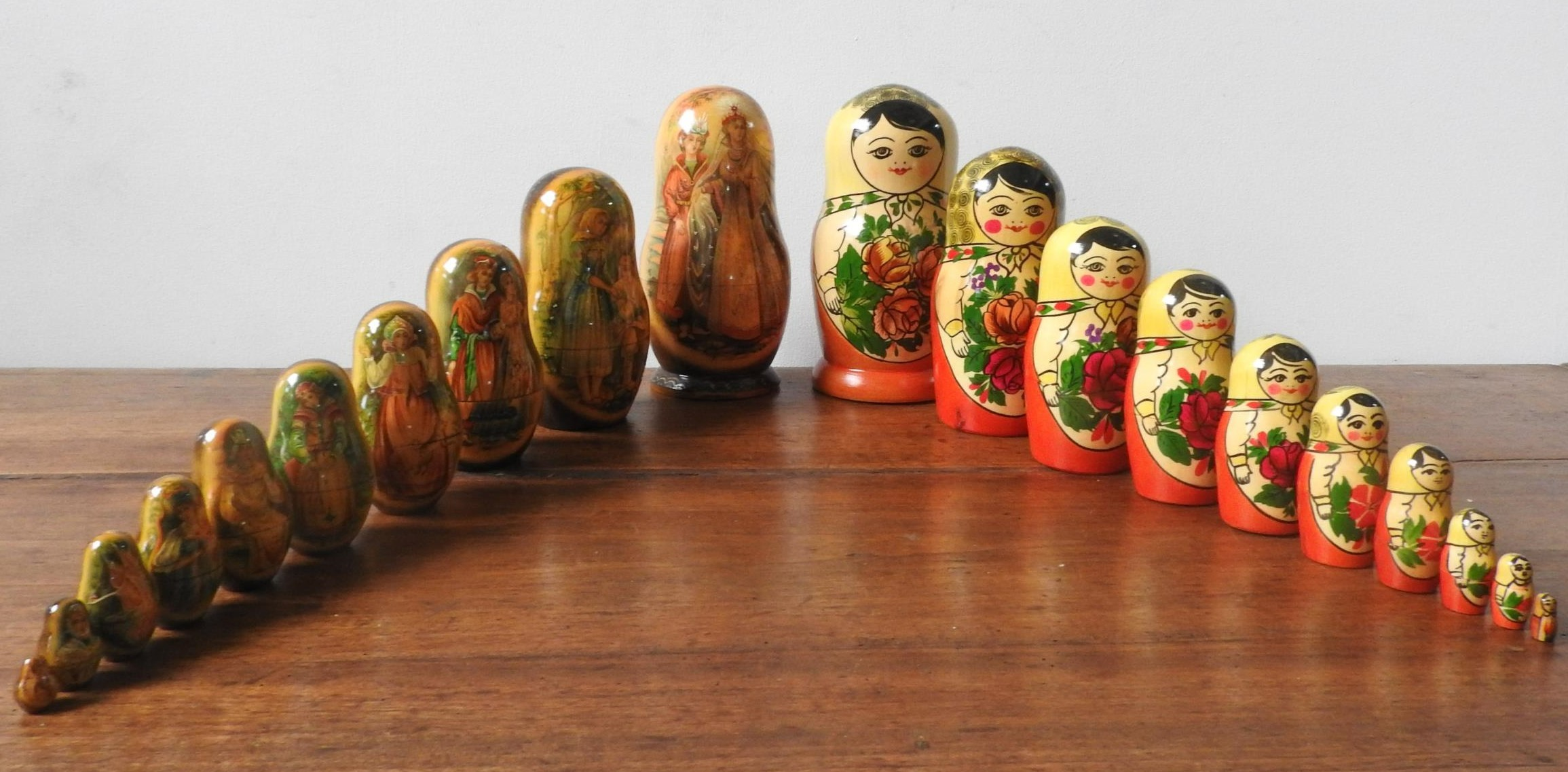 TWO SETS OF STACKING GRADUATED RUSSIAN DOLLS, ten dolls in each set, one set in traditional doll - Image 2 of 4