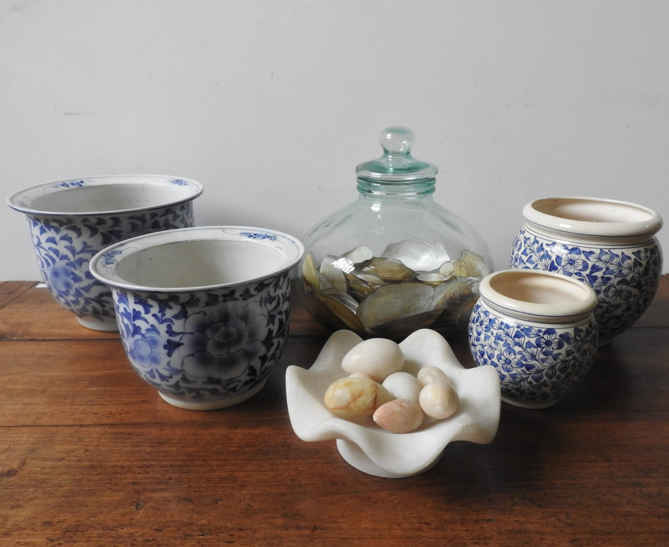 FOUR BLUE AND WHITE GLAZED JARDINIERES, ALABASTER BOWL AND EGG ORNAMENTS AND A LARGE GLASS JAR