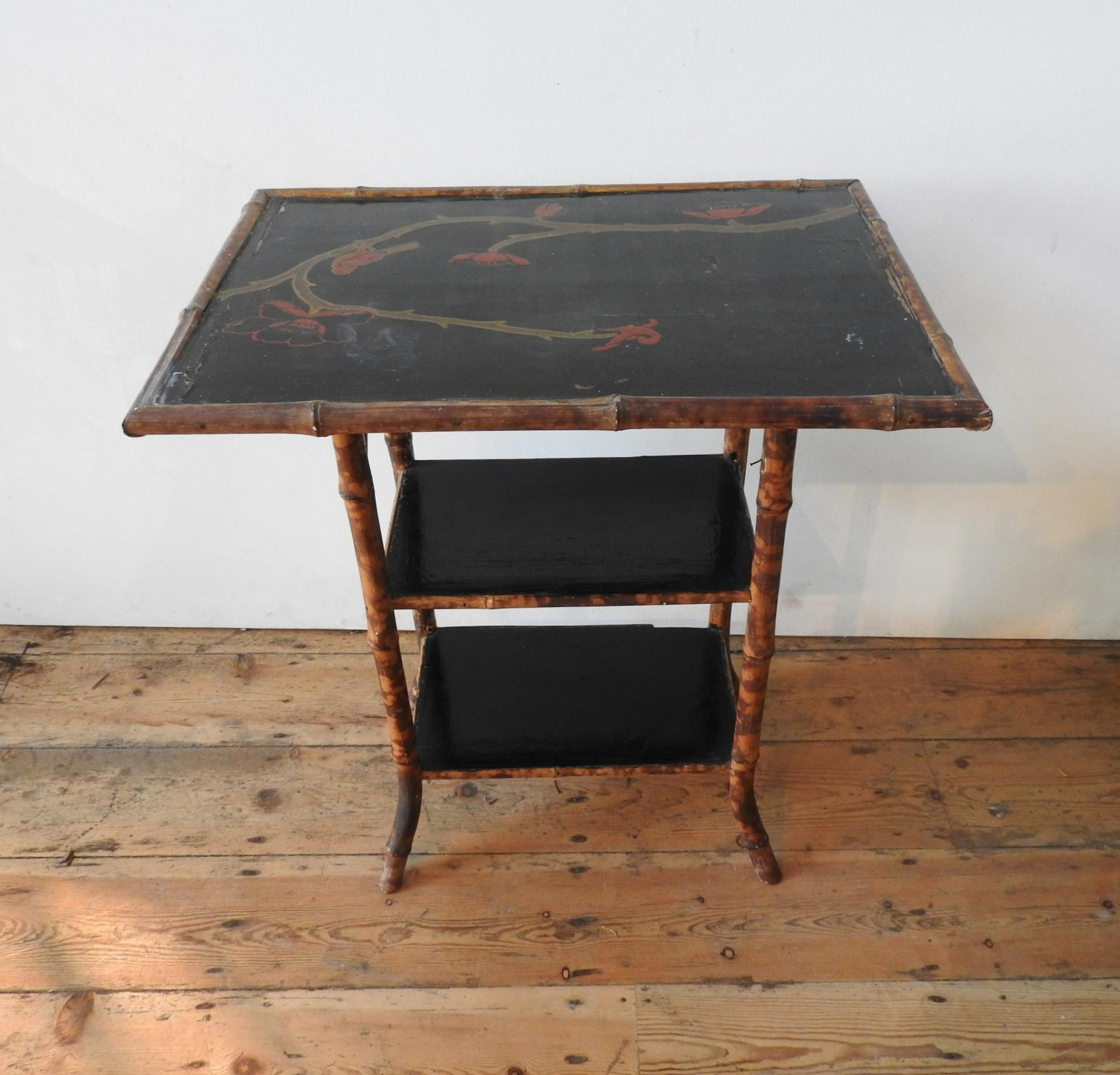 A VICTORIAN LACQUERED BAMBOO THREE TIER OCCASIONAL TABLE, 73 x 65 x 45 cm