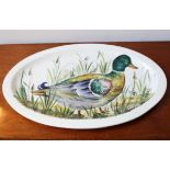 AN ITALIAN HAND PAINTED OVAL PLATTER DECORATED WITH PICTURE OF MALLARD DUCK IN REEDS,