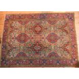 A LARGE FLORAL BORDER PATTERN RED AND BLUE CARPET, 222 x 296 cm