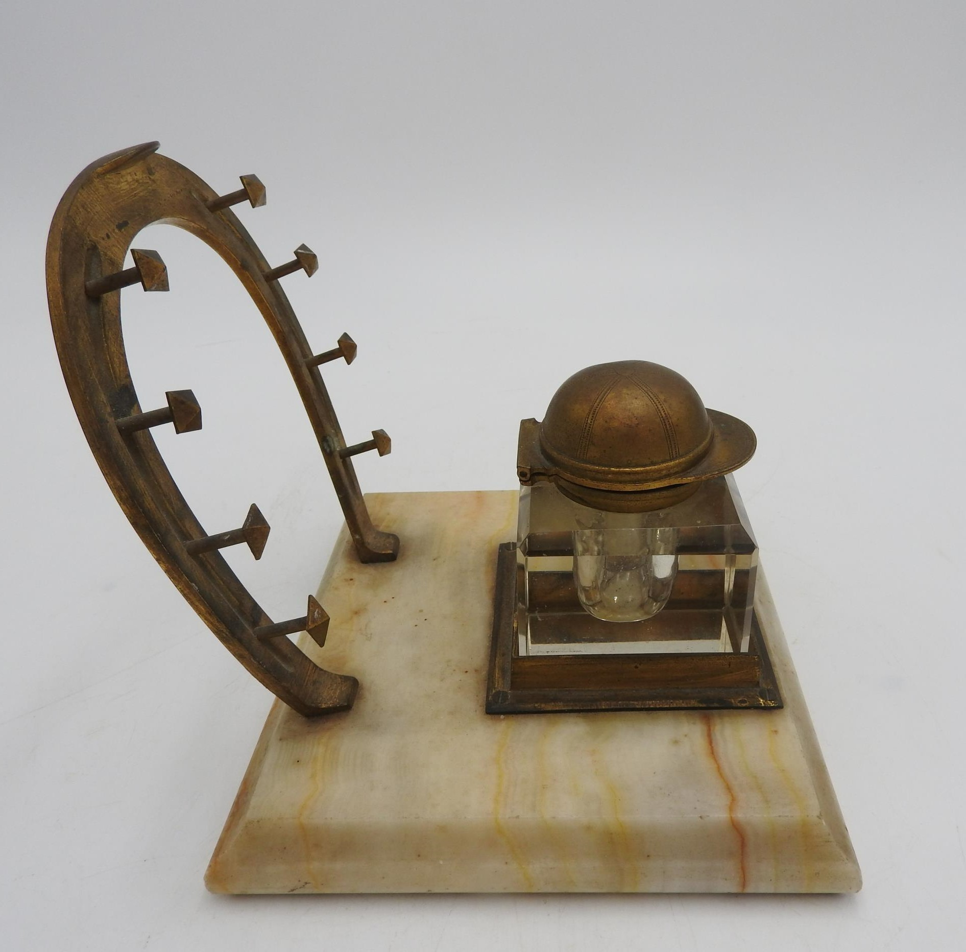 A NOVELTY JOCKEY'S INKWELL STAND, comprising of a horseshoe shaped pen rack and an inkwell with a - Image 4 of 4
