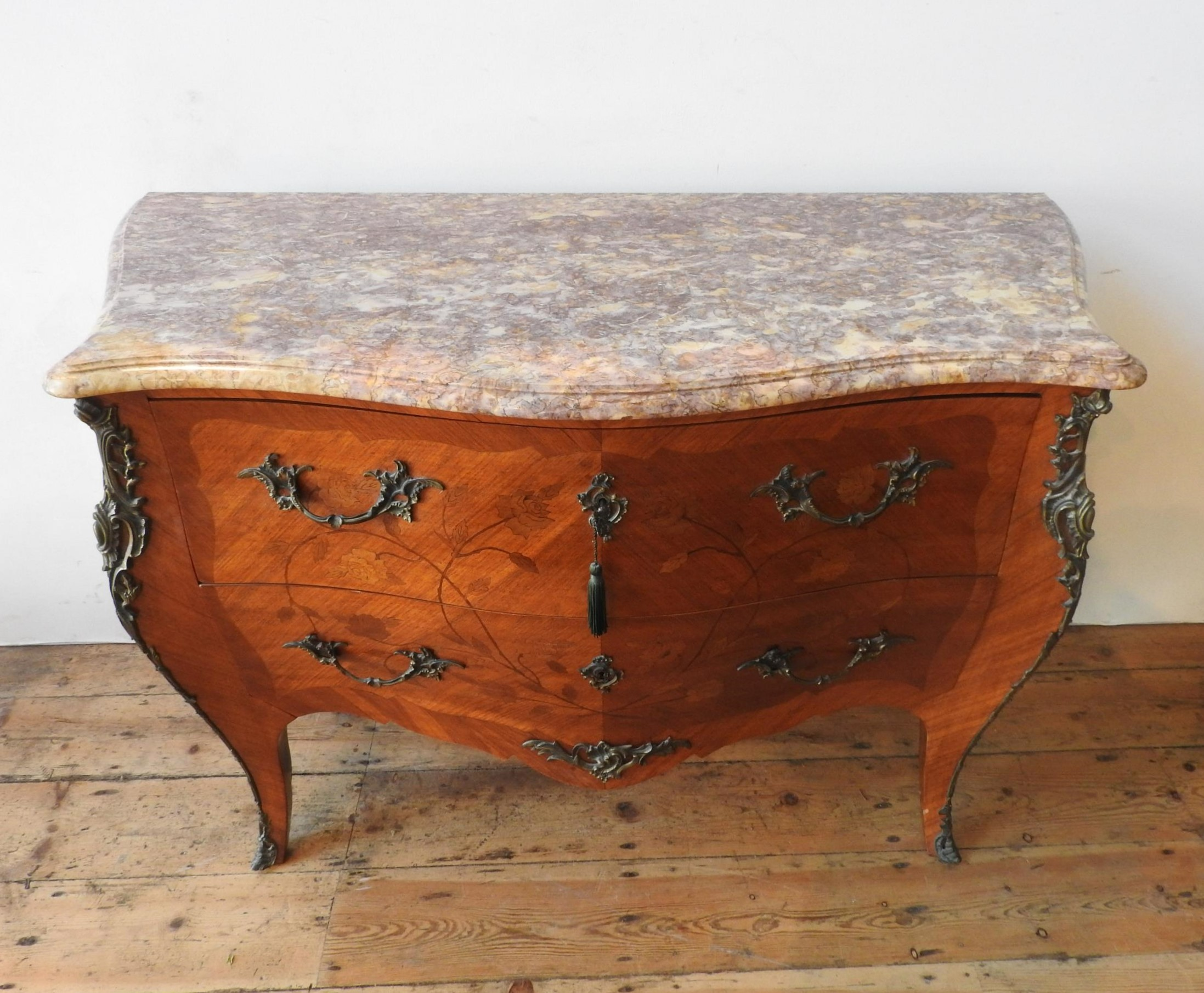 A 20th CENTURY LOUIS XV STYLE CONTINENTAL MARBLE TOP BOMBE CHEST, the two drawer chest with floral