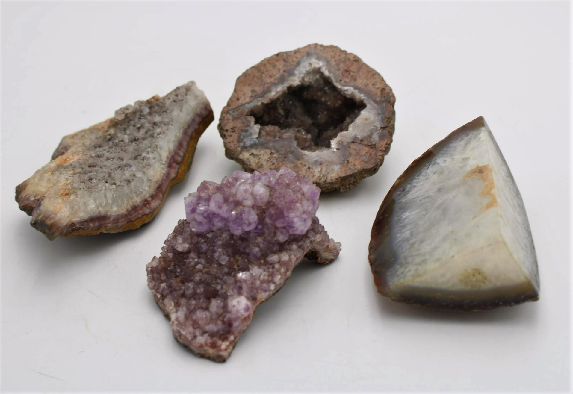 THREE PIECES OF ROCK CRYSTAL INCLUDING AMETHYST CRYSTAL FRAGMENT, AND A WORKED CRYSTAL ORNAMENT