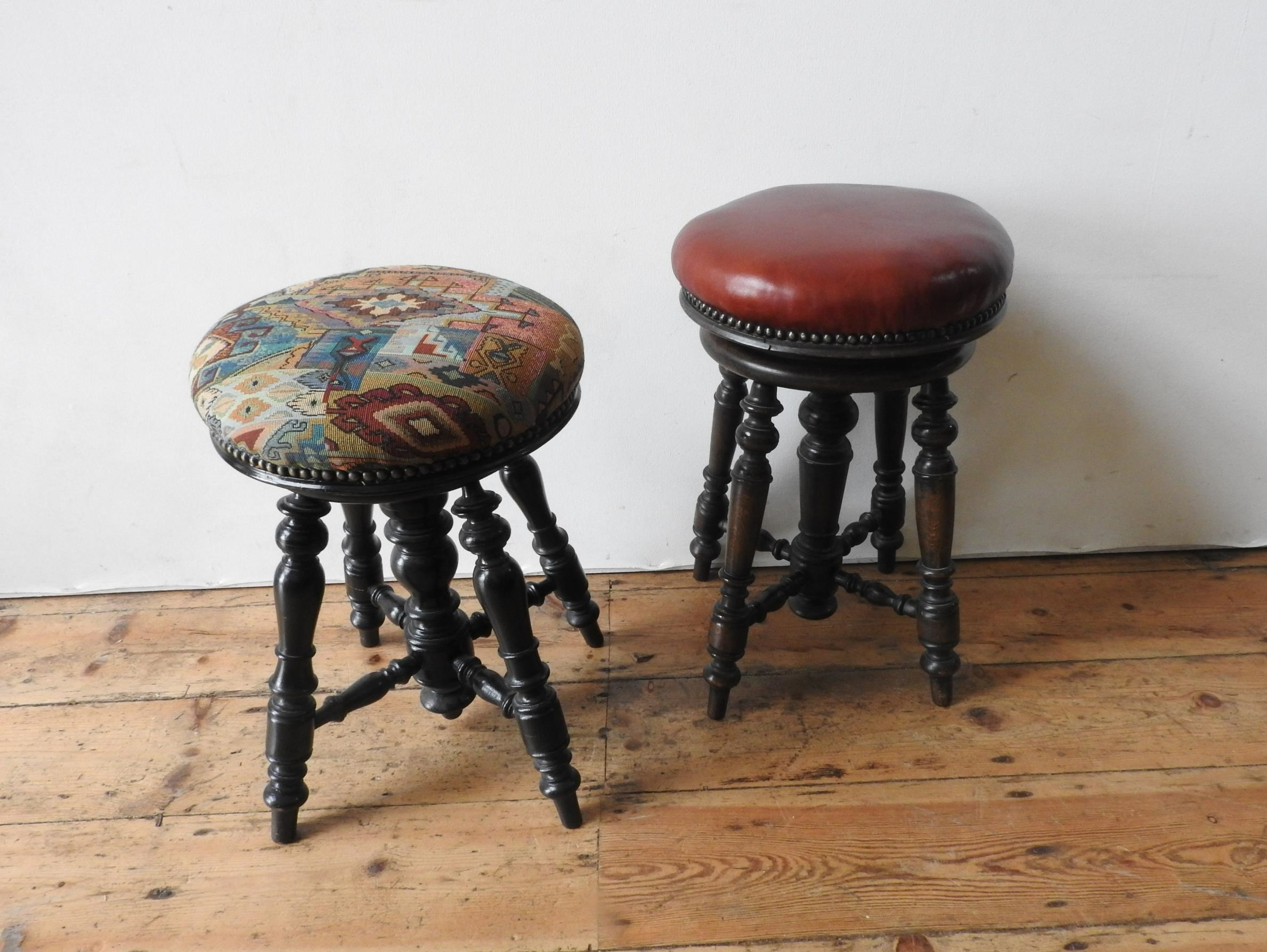 TWO VICTORIAN ADJUSTABLE CIRCULAR PIANO STOOLS, both on ornate turned oak bases, 25cm dia and - Image 2 of 2