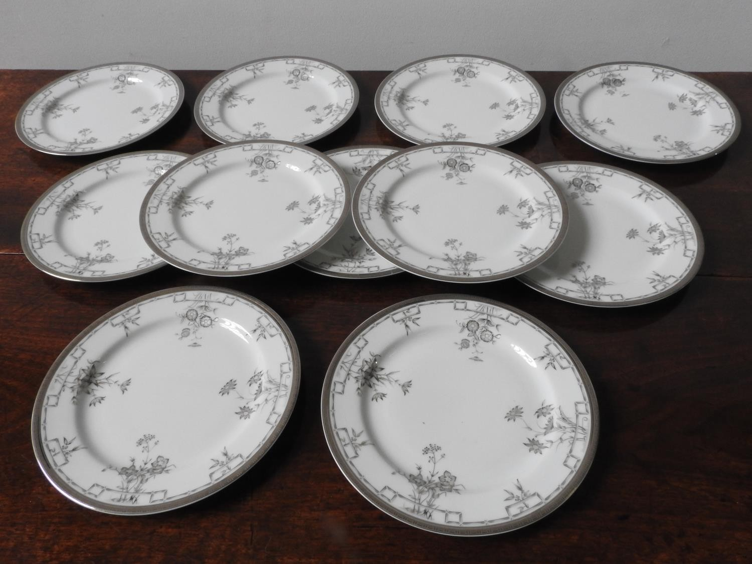 SET OF TEN CHRISTOFLE 'FLEUR D'ARGENT' PLATES MODERN together with another repaired example 21cm