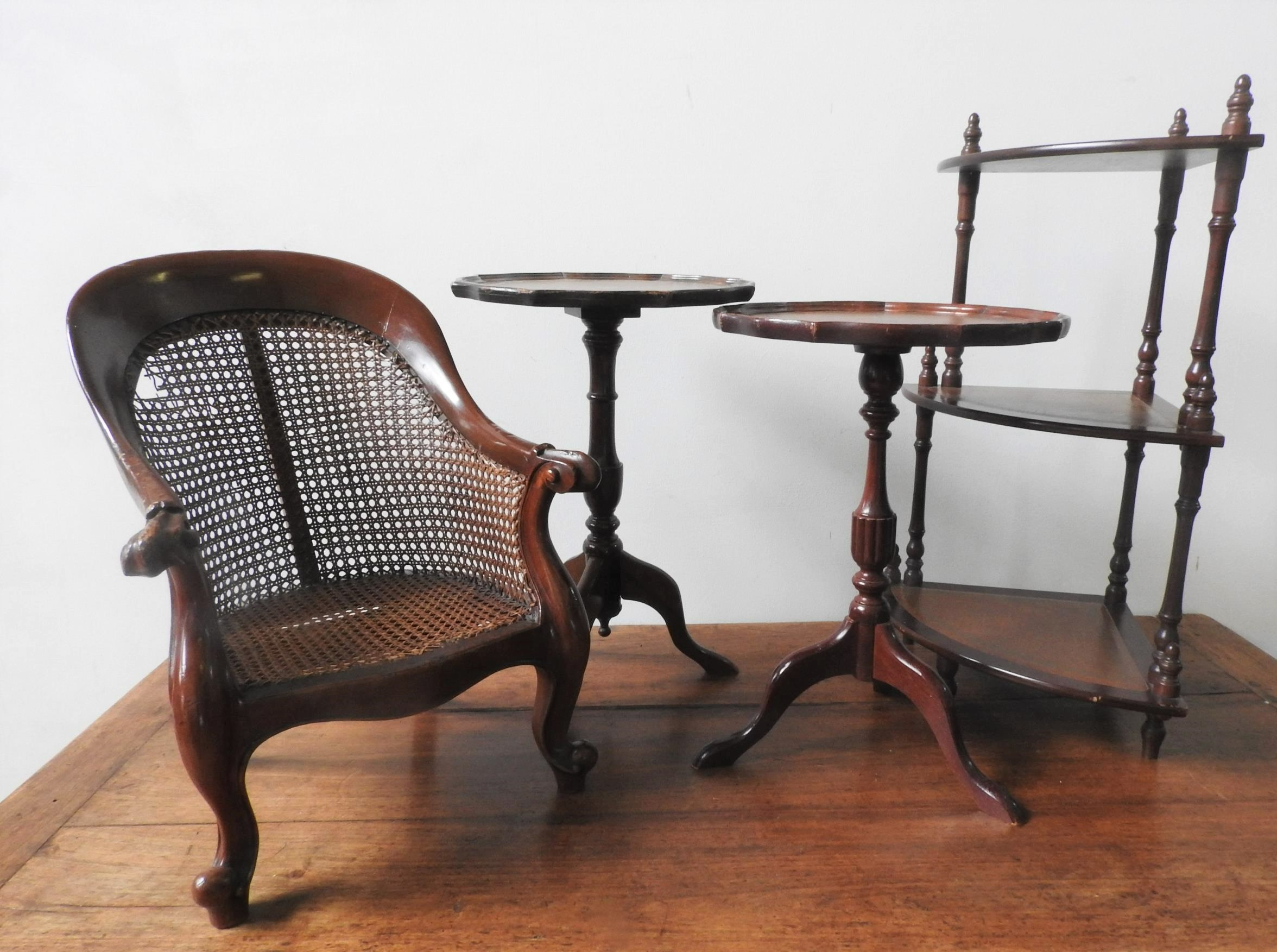 A CHILD'S MAHOGANY FRAMED CANE ARMCHAIR, TWO 20TH CENTURY WINE TABLES AND 3-TIER CORNER WHAT NOT,