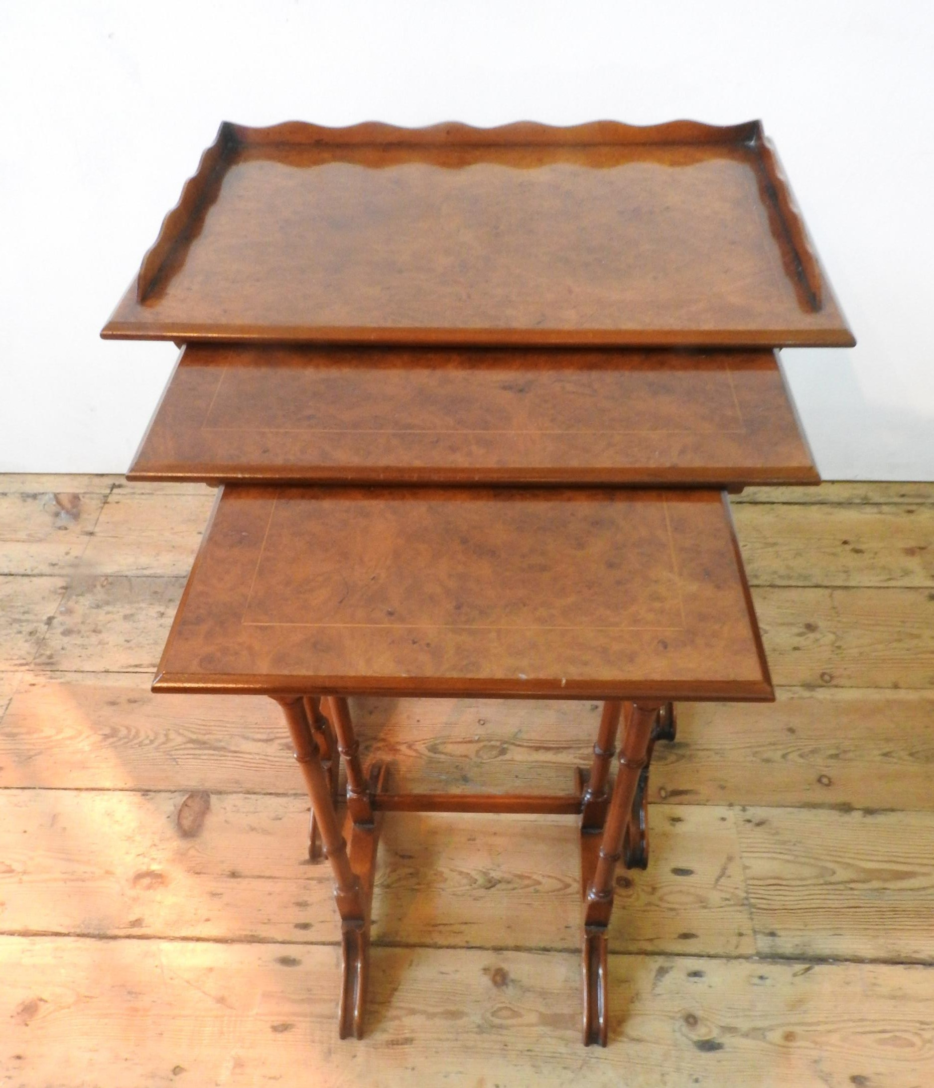 A BRIGHTS OF NETTLEBED NEST OF THREE BURR WALNUT TABLES, all with turned spindle legs, the largest - Image 4 of 4