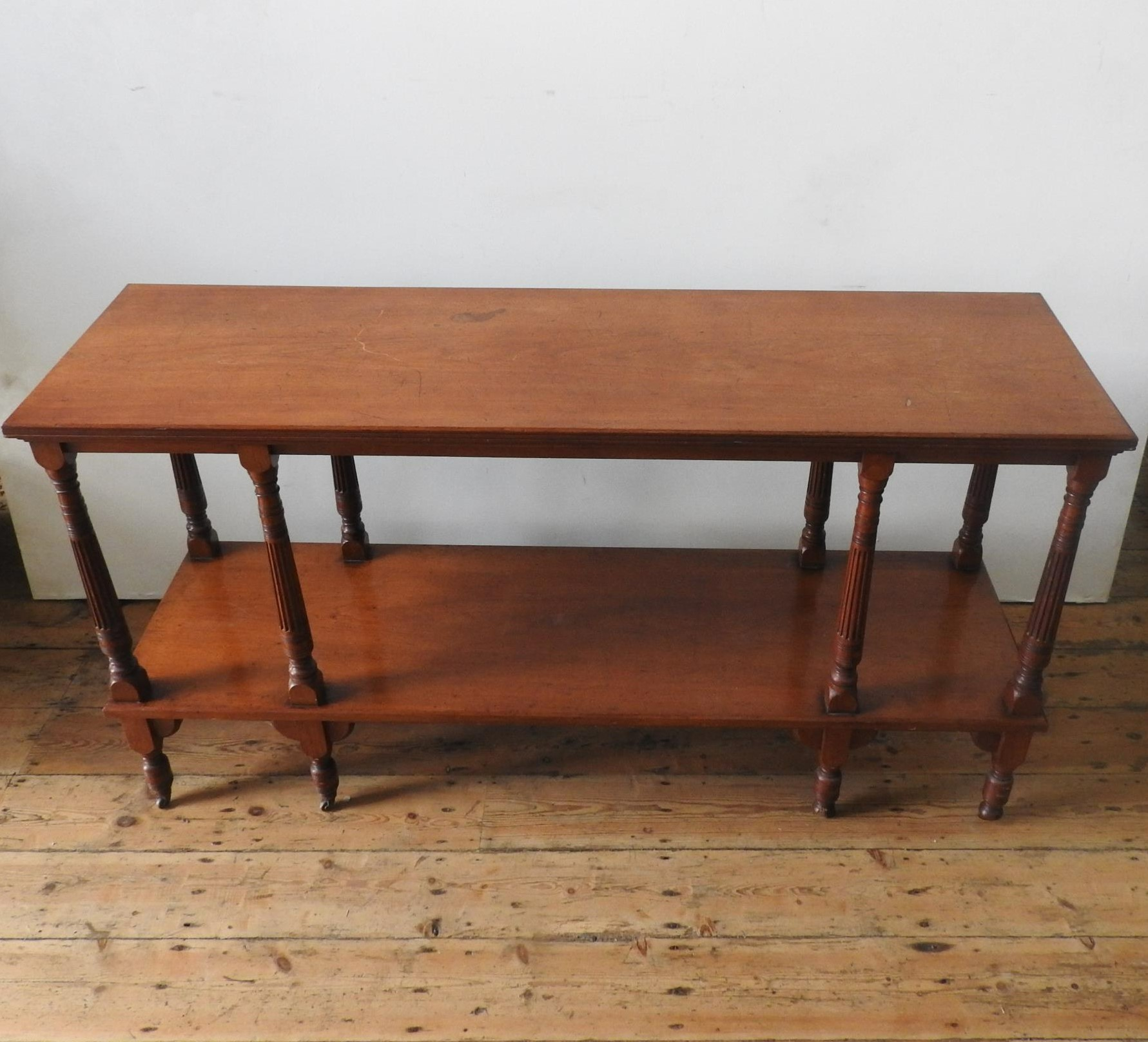 A LATE VICTORIAN MAHOGANY 2-TIER BUFFET, on eight turned legs with eight fluted tapered supporting