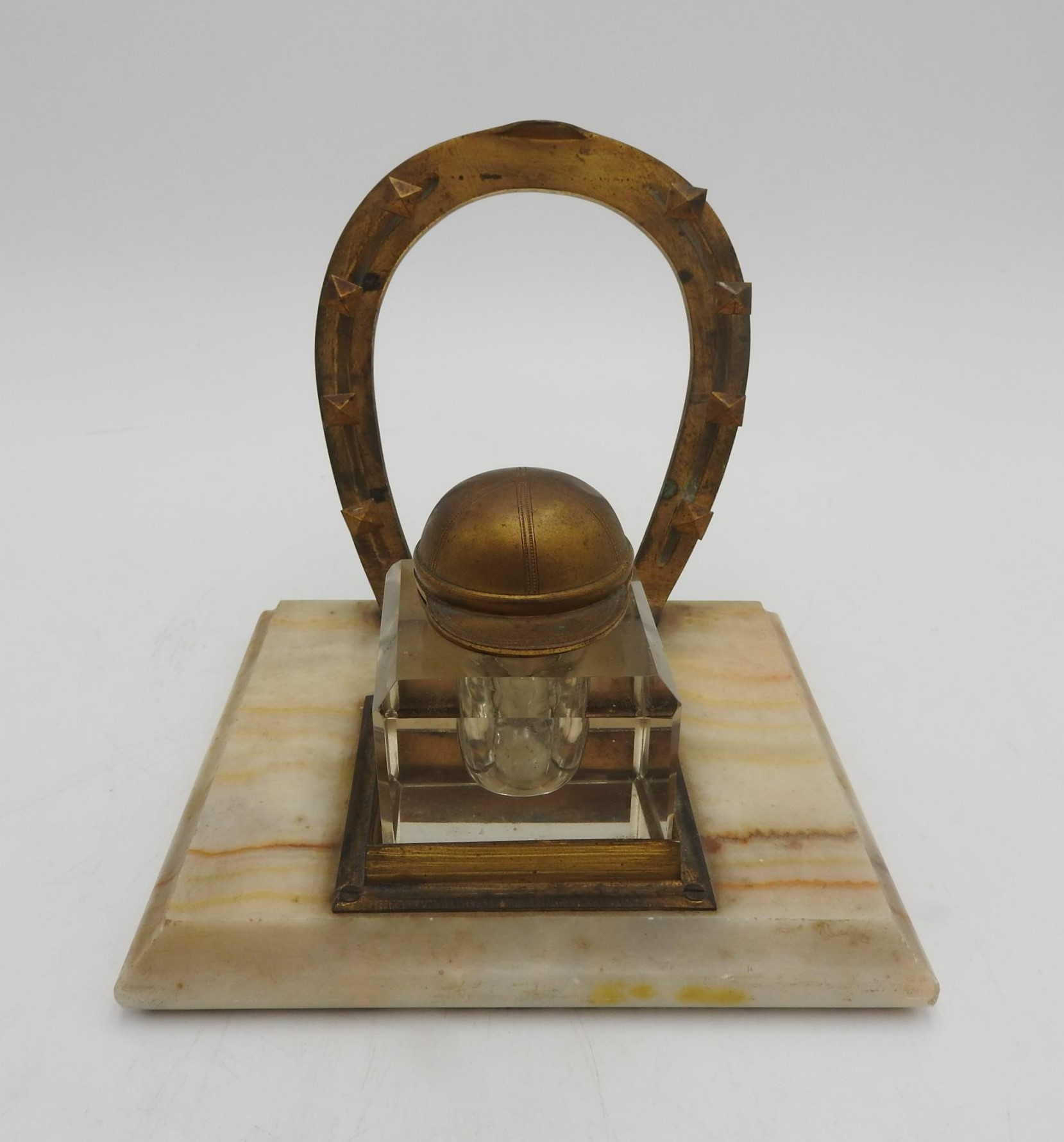 A NOVELTY JOCKEY'S INKWELL STAND, comprising of a horseshoe shaped pen rack and an inkwell with a - Image 2 of 4