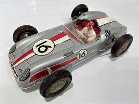 JOUSTRA AUTO DE COURSE 1960's FRICTION TIN PLATE RACER Large scale friction model reminiscent of the