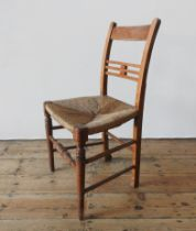 A RUSTIC RUSH SEAT SINGLE COUNTRY CHAIR