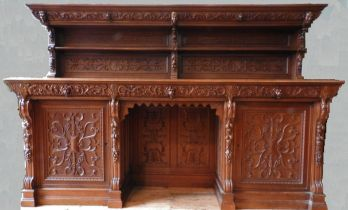 AN ORNATE CARVED OAK 19TH CENTURY CONTINENTAL SIDEBOARD, consisting of of an ornate carved back