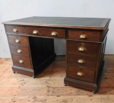 AN OAK 1930'S TWIN PEDESTAL WRITING DESK, with two banks of three drawers on pedestals, two short