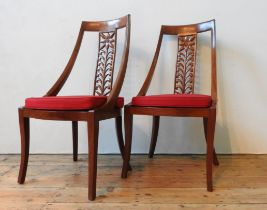 A SET OF EIGHT 20TH CENTURY ANGLO-CHINESE ROSEWOOD DINING CHAIRS, with floral carved splats, elegant