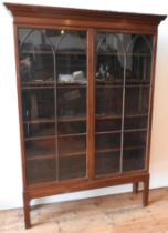 A GEORGE III MAHOGANY GLAZED TWO DOOR DISPLAY CABINET ,on square legs with narrow Grecian style