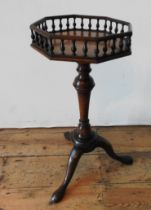 A 19TH CENTURY WALNUT TRIPOD TABLE WITH GALLERY EDGED OCTAGONAL TOP, with a tapered turned