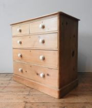 A VICTORIAN WAXED PINE CHEST OF FIVE DRAWERS, two short drawers over three long drawers, with