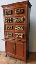 AN ANGLO-CHINESE ROSEWOOD DRINKS CABINET, with eight carved gilded panels, top cupboard contains
