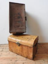A VINTAGE TIN TRUNK AND A VINTAGE CANVAS COVERED TRUNK