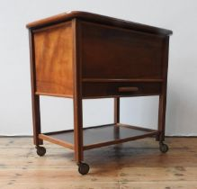 A MID 20TH CENTURY MAHOGANY SEWING TABLE, with a lift top, shelf below, on four casters, 63 x 62 x