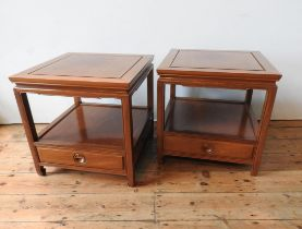 A PAIR OF ANGLO-CHINESE ROSEWOOD TWO TIER SIDE TABLES WITH SINGLE DRAWERS, produced in Hong Kong