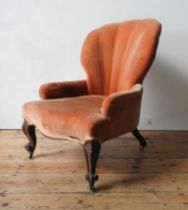 A VICTORIAN MAHOGANY FRAMED SEWING CHAIR, with shell style upholstered back, on carved cabriole legs