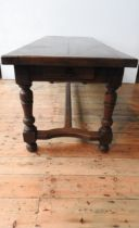 A 19TH CENTURY FRENCH OAK FARMHOUSE TABLE ON TURNED LEGS