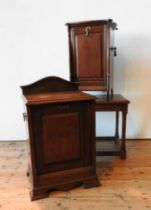 TWO VICTORIAN COAL PURDONIUMS AND AN OAK COFFEE TABLE, one oak and one mahogany purdonium, the