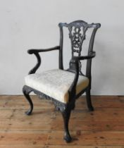 A 19TH CENTURY ORNATE CARVED MAHOGANY ELBOW CHAIR, with an pierced carved splat back with ribbon and