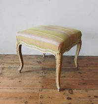 A FRENCH 19TH CENTURY GILDED SALON STOOL, on cabriolet legs, 37cm high, 49cm square