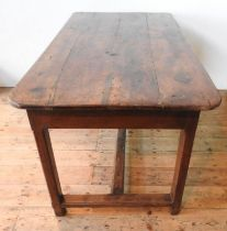 A FRENCH 19TH CENTURY RUSTIC FRUITWOOD FARMHOUSE TABLE WITH DRAWER, the square legs supported by a