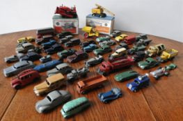 A COLLECTION OF VINTAGE DINKY MODEL VEHICLES INCLUDING BOXED DINKY SUPERTOYS CRANE & BULLDOZER, 52