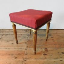 A CONTINENTAL 19TH CENTURY GILT WOODEN STOOL, the upholstered square seat supported by four