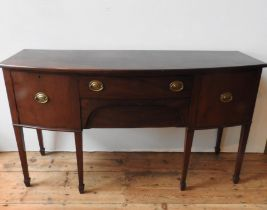 AN EARLY 19TH CENTURY MAHOGANY INLAID BOW FRONT SIDE BOARD, with two drawers, two doors with