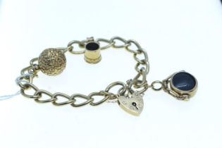 9ct gold bracelet with heart-shaped padlock clasp, suspending three charms including two 9ct gold &